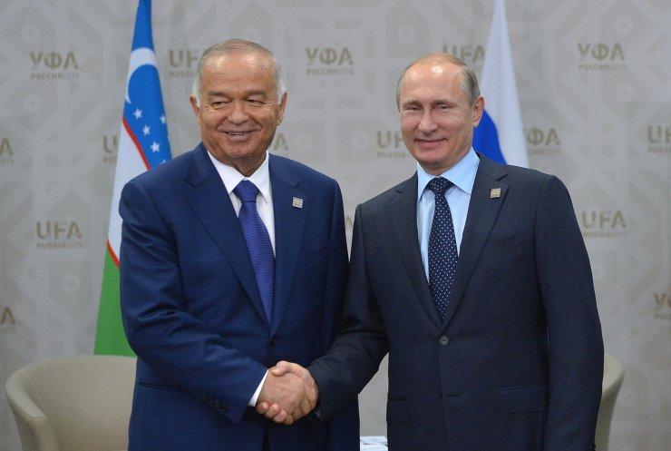 Russian President Vladimir Putin meets with President of Uzbekistan Islam Karimov